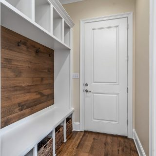 Everyone needs entry way built-ins to stay organized! We love the mix of white and natural wood grain in Kirby Cole's (Cole Home Builders) home (available for sale) in The Grove! Call or drop by to see it in person. #shreveporthomesforsale #shreveporthomes #entrywayideas