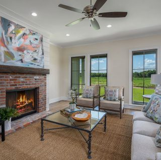 A cozy fireside spot with a view in 2025 Garrett Farms Row! #shreveporthomesforsale #shreveportrealtor